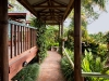 Covered walkway to guest rooms at Tamborine Mountain Bed and Breakfast