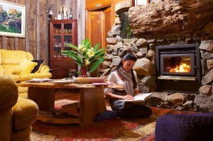 Guest relaxing by raging fire at Tamborine Mountain Bed and Breakfast