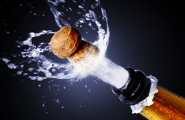 popping-the-cork-bottle-of-bubbly