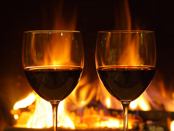 romantic-dinner-glasses-open-fire