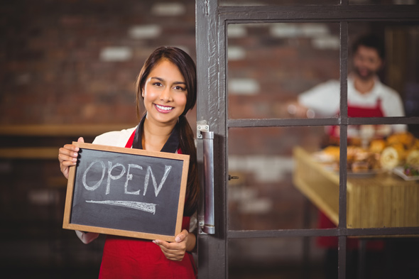 woman-holding-open-sign