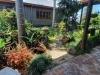 tmbb-building-nestled-in-lush-gardens