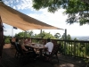 Guests enjoying breakfast on the deck at Tamborine Mountain Bed and Breakfast